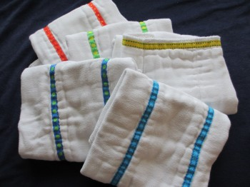 sew ribbons onto cloth diapers