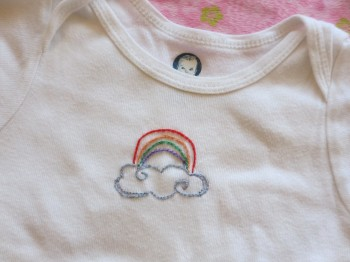 rainbow embroidered on onesie