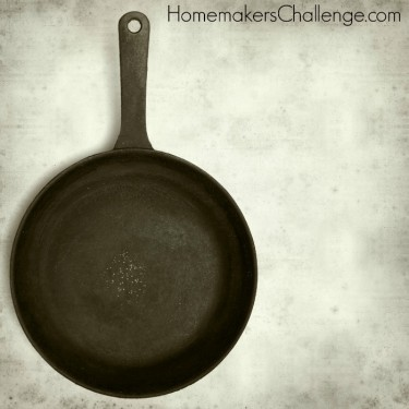 textured old paper background with cast iron frying pan