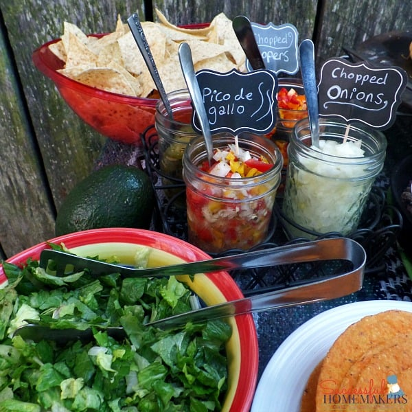 Lettuce, condiments, and chips are all on this Taco Bar Made Easy ~ Successful Homemakers