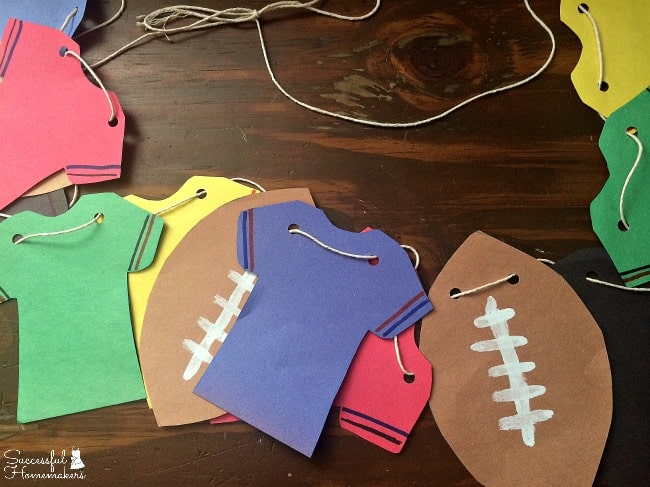 Game Day Spread In A Jiffy with Tyson®- Make this simple football banner with colored paper, easy templates, and string!