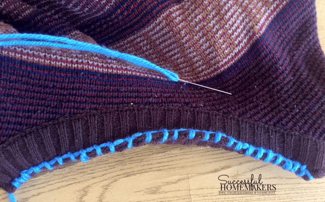 How to Make a Pet Bed in an Hour use a blanket stitch to close the neck of the sweater